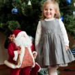 Cute little girl with toy Santa Claus — Stock Photo #3182284