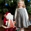 Stock Photo: Cute little girl with toy Santa Claus