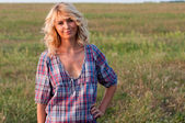 Beautiful blondie in a countryside — Stock Photo