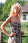Beautiful blondie in the village — Stock Photo