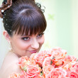 Stock Photo: Young beautiful bride with rose