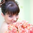 Young beautiful bride with rose — Stock Photo #2749157