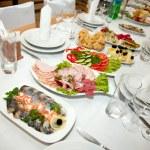 Food at banquet table — Stock Photo
