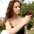 Woman with mobile phone — Stock Photo #2890953