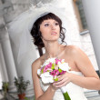 Foto Stock: Young beautiful bride outdoor