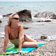Young beautiful woman relaxing on beach — Stock Photo #3593642