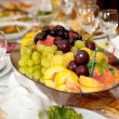 Fruits at banquet table — Stock Photo