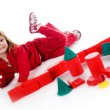 Little girl with red blocks - Stock Photo