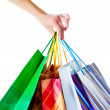 Shopper holding shopping bags — Stock Photo