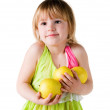 Little girl with armful of apples — Stock Photo
