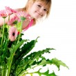 Cute little girl with the pink wlowers — Stock Photo