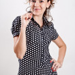 Beautiful woman in a black polka dot dress — Stock Photo