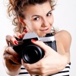 Beautiful woman in a sailor's shirt with camera — Stock Photo
