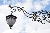 Forged pattern streetlamp — Stock Photo