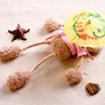 Plush toy under the beach umbrella — Stock Photo #3736174