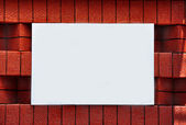 Blank sign on a brick wall — Stock Photo
