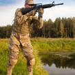 Soldier with a rifle - Stock Photo