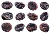 Prunes set isolated on white background. — Stock Photo