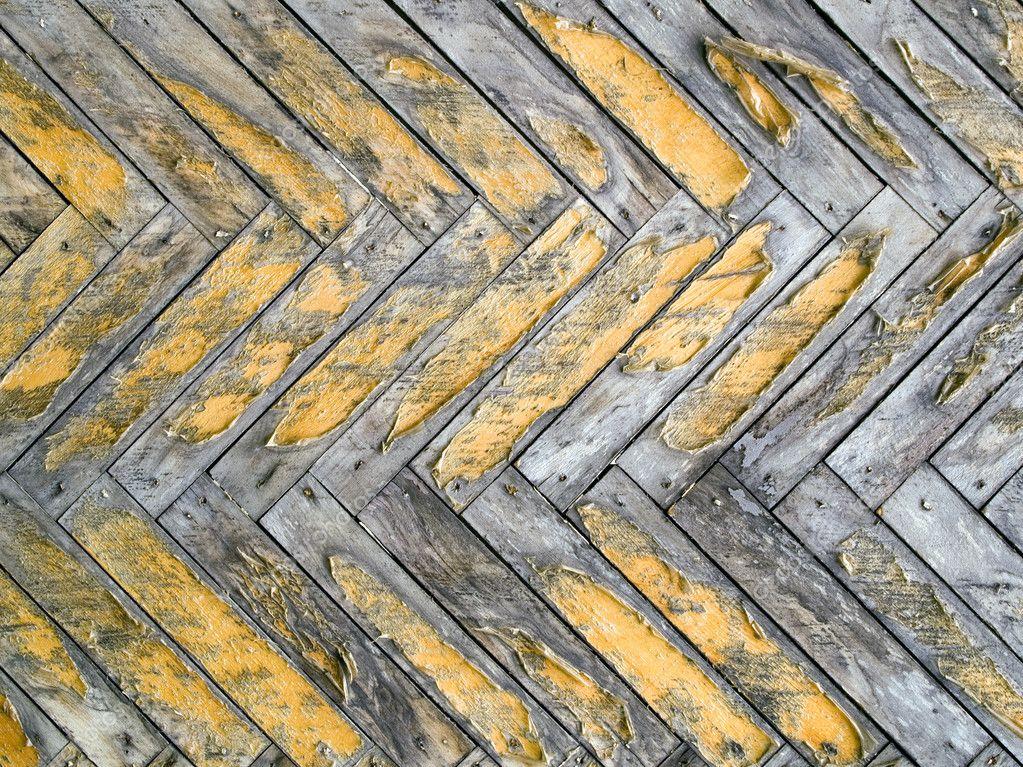 老鲱鱼骨镶木地板图案特写背景–