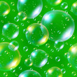 Stock Photo: Seamless soap bubbles on green background.