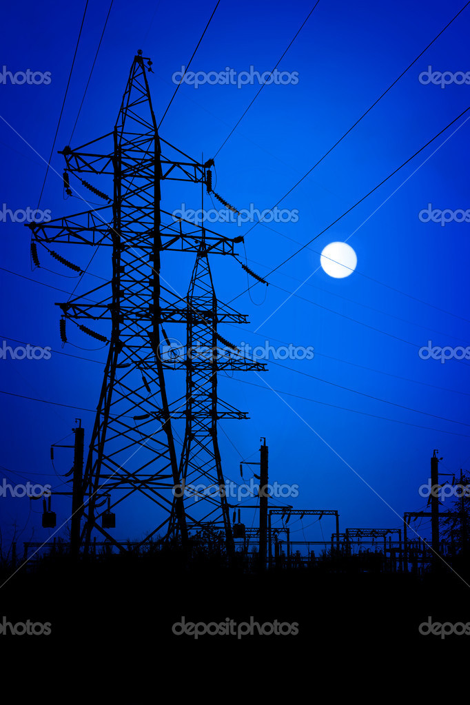 Transmission towers on night background.  Stock Photo #3837009