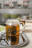 Glass tea pot with fresh green tea — Stok fotoğraf