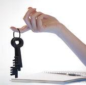 Woman's hand holding retro keys — Stock Photo
