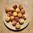 Ripe peaches on a plate — Stock Photo #3547450