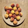 Ripe peaches on plate — Stock Photo #3547450