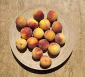 Ripe peaches on a plate — Stock Photo