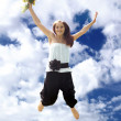 Young woman in jump — Stock Photo