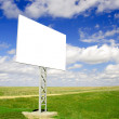 Blank Billboard in field - Stock Photo