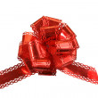 Big red holiday bow on white background — Stock Photo