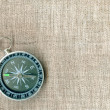 Compass on canvas as background — Stock Photo
