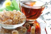 Brown sugar with tea — Stock Photo