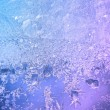 Stock Photo: Frozen ice on window glass