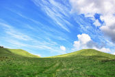 Landscape in early spring in the field, cloudy sky and the mount — Stock Photo
