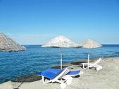 Playa con silla — Foto de Stock