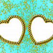Gold heart-shaped frame on blue floral background — Stock Photo