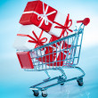 Shopping cart and gift — Stock Photo