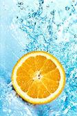 Orange and water — Stock Photo