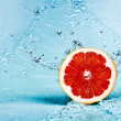 Grapefruit and water - Stock Photo