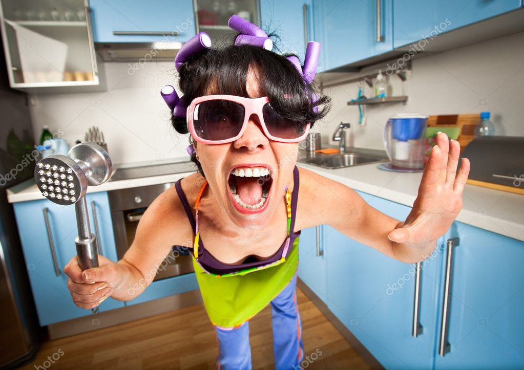 Crazy housewife in an interior of the kitchen — Stock Photo #3732246