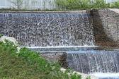 Cascade of artificial waterfalls — Stock Photo