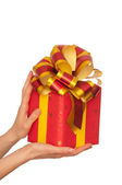 Gift with yellow bow — Stock Photo