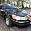 Black Wedding Limousine. Ornated with flowers. - Photo
