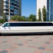 White Wedding Limousine. Ornated with flowers. - Stock Photo