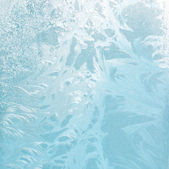 Frosty natural pattern on winter glass — Stock Photo