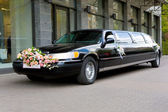 Wedding limousine near the shop — Stock Photo