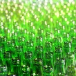 Bunch of green glass bottles. Soft focus. — Stock Photo